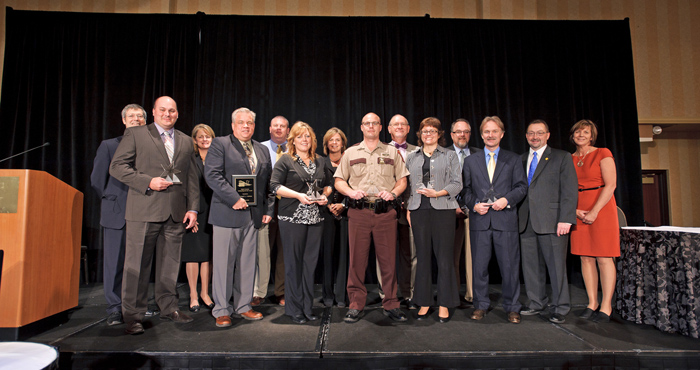 TZD leadership and Minnesota's commissioners of health, public safety, and transportation with the 2012 award recipients